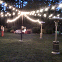 Bare bulb lighting can extend an outdoor party with little costs