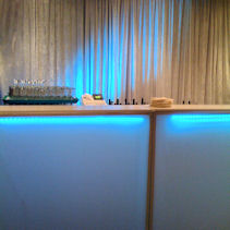 Lighted bars illuminate where the mixologists make most of the crowd pump up the party