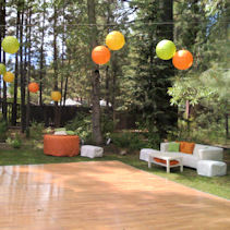 Outside party with lounge furniture and dance floor