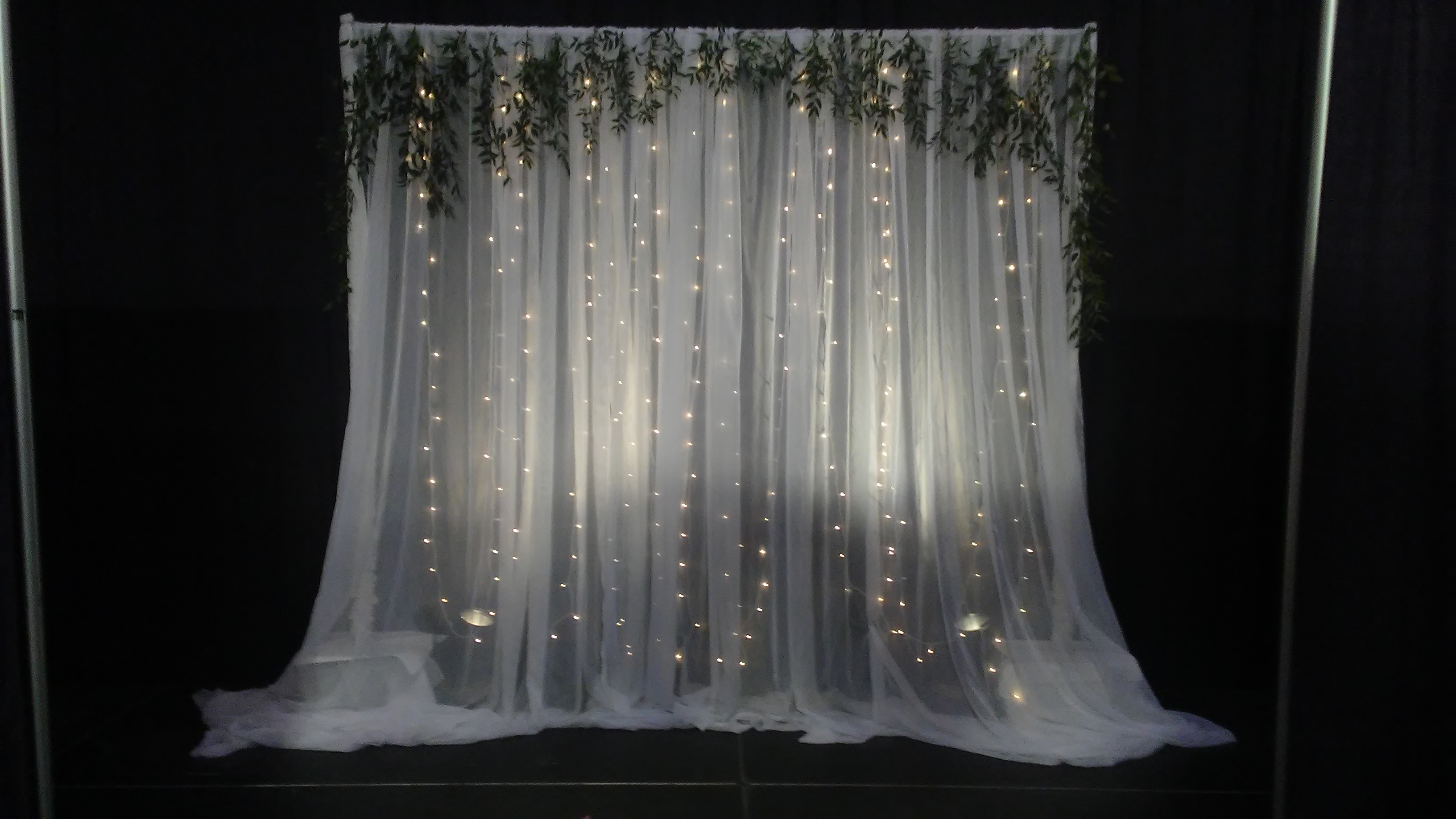 Sparkle Wall with a greenery valance gorgeous!