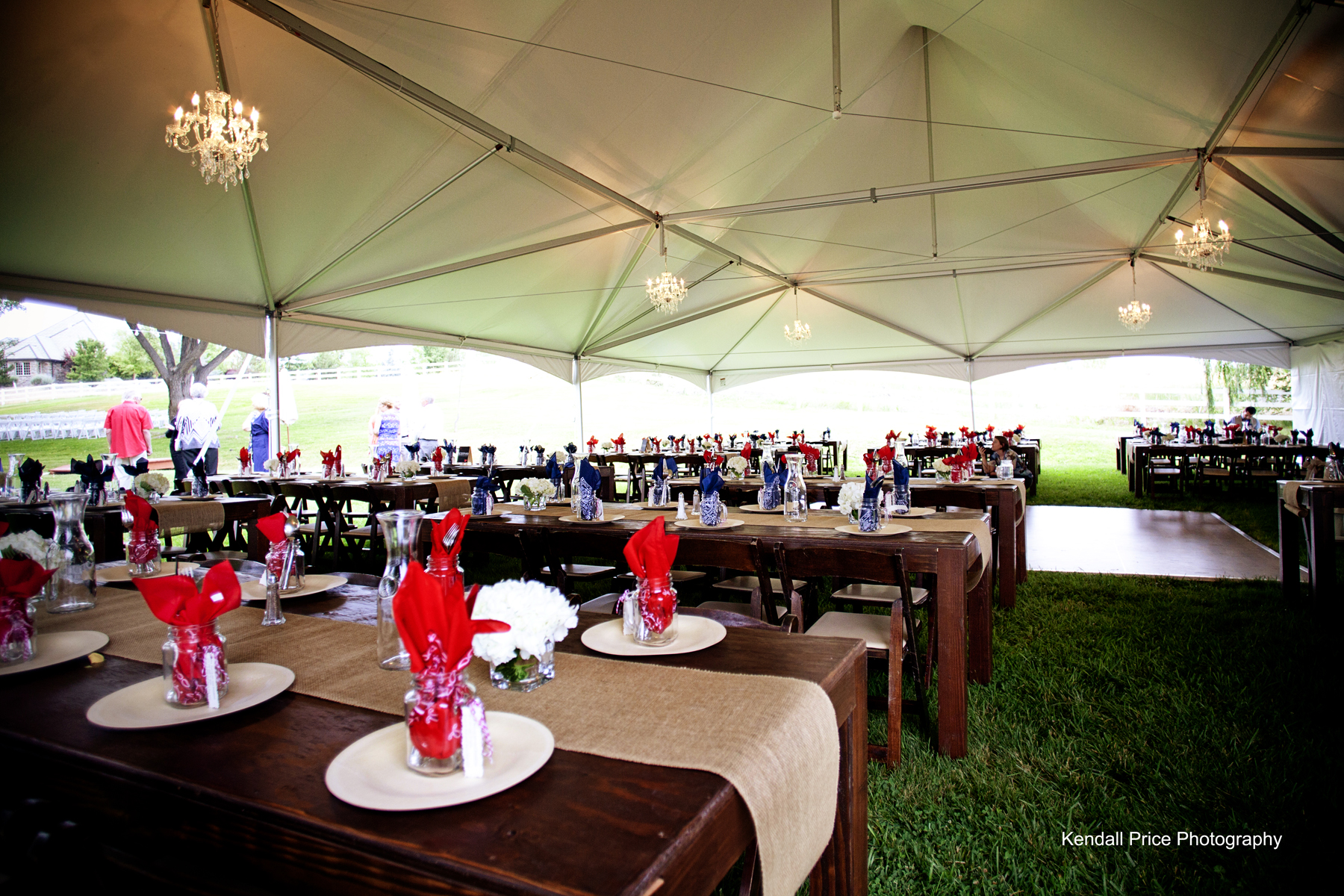 Tent with Farm Tables dance floor and chandeliers