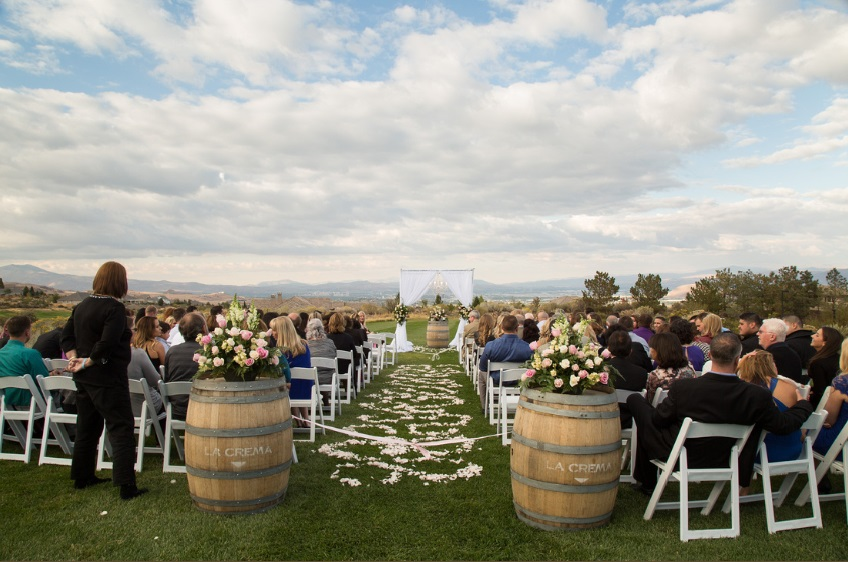 Wine Barrels and White Fabric Chuppah adorned this Wedding in Reno