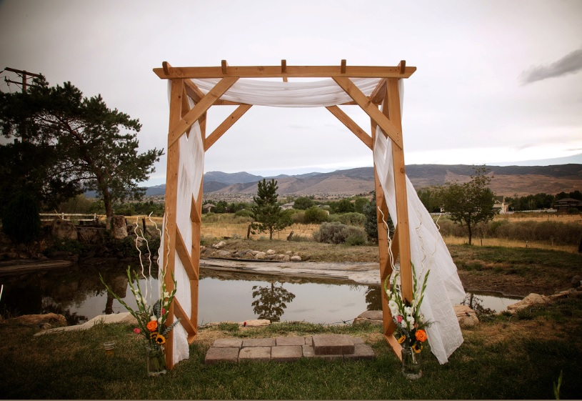 Blonde Pergola Arch can be color coordinated with your wedding simply by adding your custom colored
