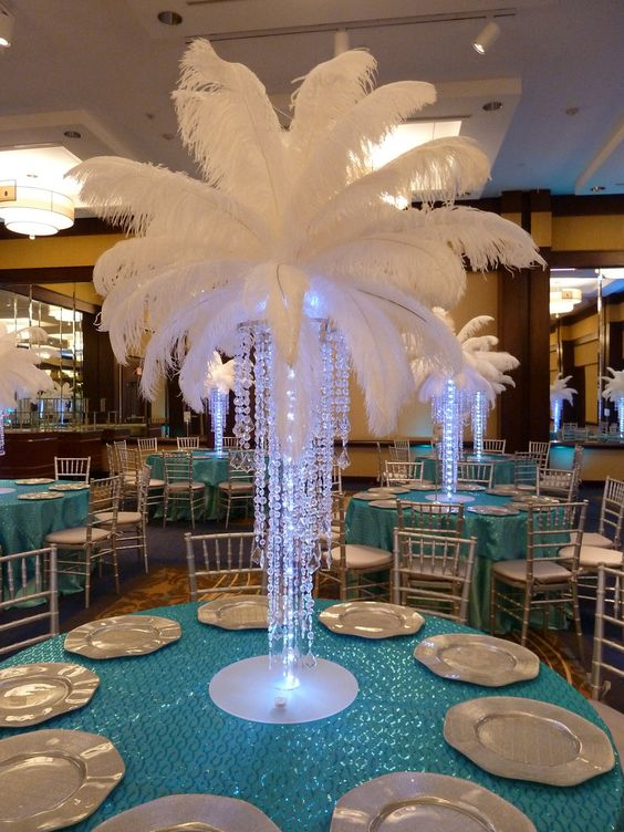 Glowing free standing Chandelier with plumes of feathers to top it off for rent in Reno