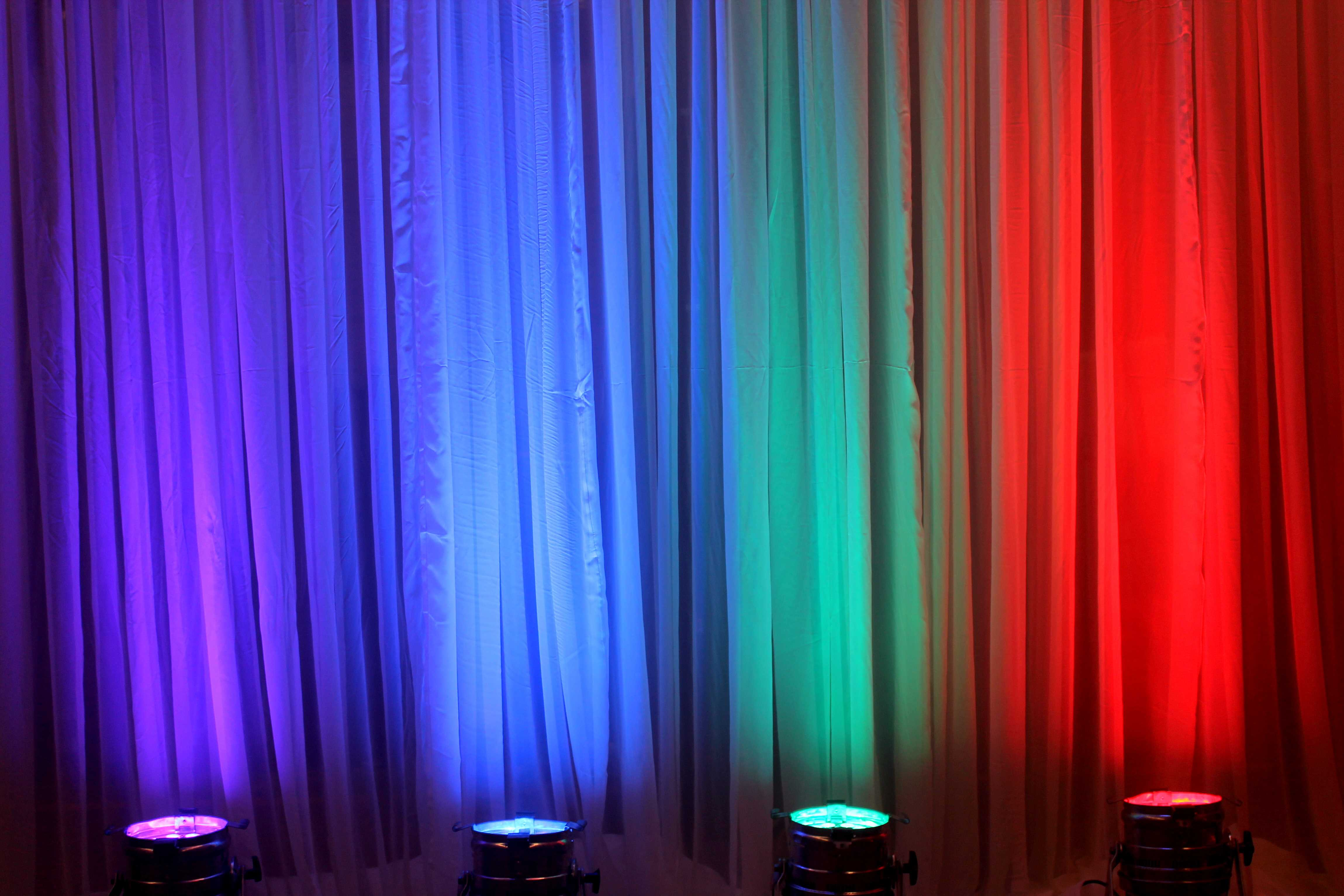 Uplights with or without colored light gels to dramatize your wedding or event